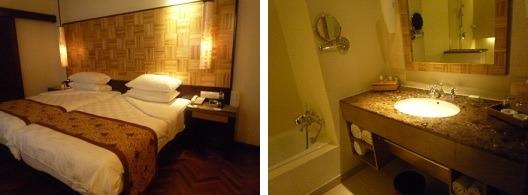 (ベッドの前にはテレビがあります)    (コンパクトで使いやすいバスルーム)