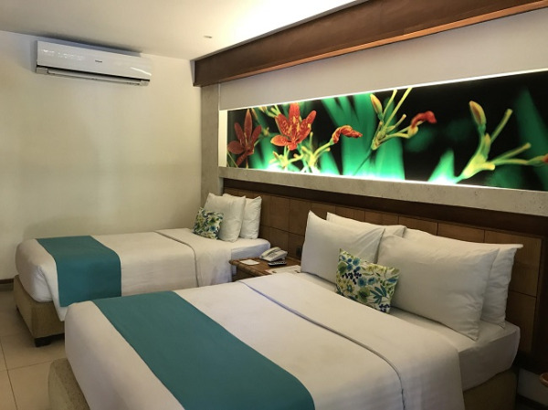 コスタベラ・トロピカル・ビーチ・ホテル デラックスプールサイドプライベートバルコニー ベッドルーム